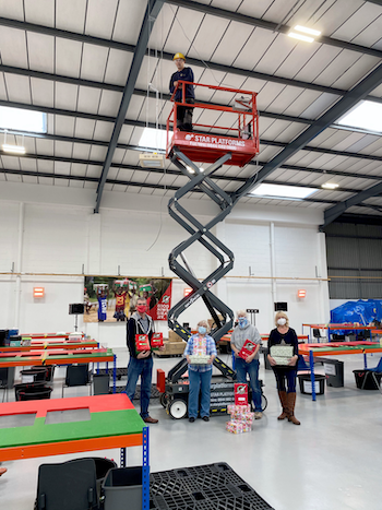 Dunstable-based Star Platforms has donated the use of a scissor lift to Christmas Shoebox project Operation Christmas Child Image Samaritan's Purse