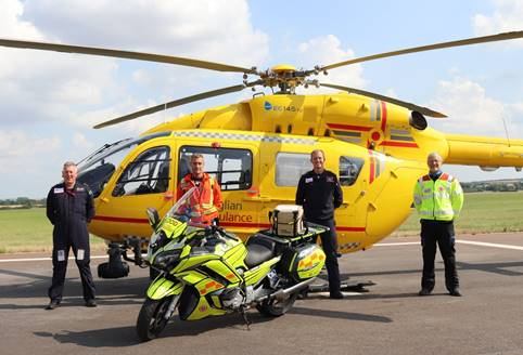 SERV Suffolk and Cambridgeshire volunteer and Operations Manager, Mick Thurman at the East Anglian Air Ambulance base at Cambridge City Airport with crew members (left to right) Pilot Andy Moorhouse, Critical Care Paramedic Joe Dowsing and Pilot Captain Matt Sandbach Credit: EAAA